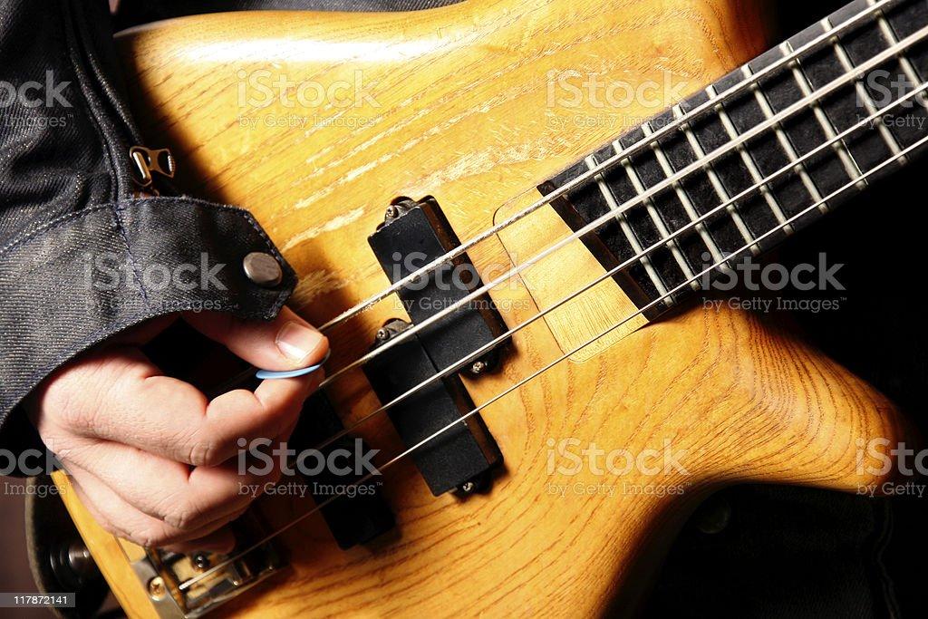 bass guitarist playing stock photo