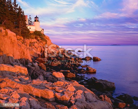 Sunrise with rocky cliffs at Bass Harbor Lighthouse Acadia National Park, Maine