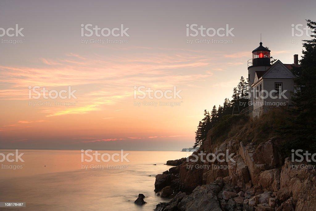 Bass Harbor Lighthouse on Rocky Coast at Sunset royalty-free stock photo