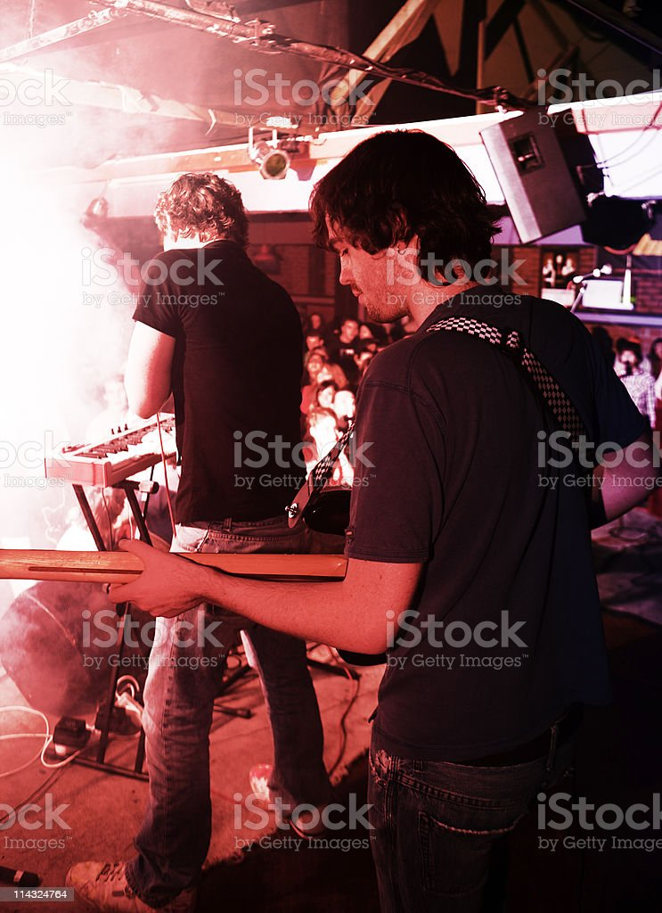 Bass player and singer on stage royalty-free stock photo