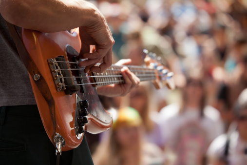 bass player in front of crowd