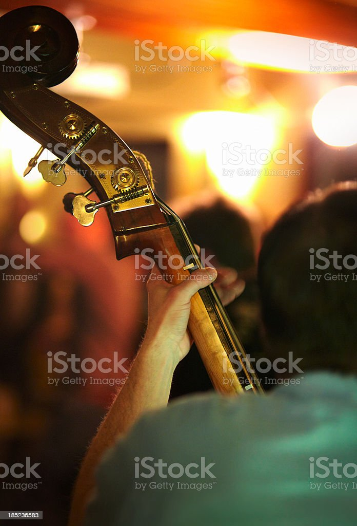 Bass player on stage stock photo