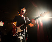 Bass player performing in a show with his rock band. The musician is model-released. Camera: Canon EOS 1Ds Mark III.