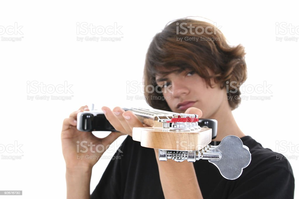 Bass Playing Teen Boy Over White royalty-free stock photo