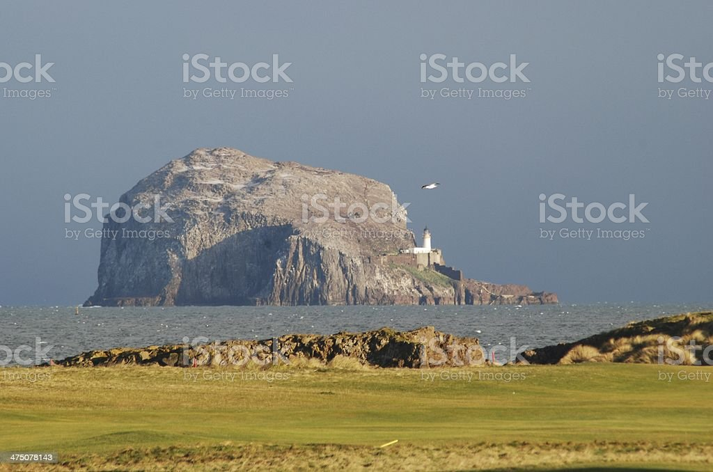 Bass Rock fro Glen Golf Club The Bass Rock and lighthouse from the Glen Golf Club at North Berwick, East Lothian, Scotland where the Scottish Seabird Centre is located. Bass Rock Stock Photo