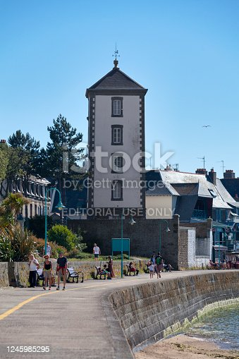 Saint-Malo, France - June 02 2020: The Bas-Sablons lighthouse is located on the quay of Bas-Sablons beach in the Saint-Servan district, a former municipality attached to the city of Saint-Malo, Ille-et-Vilaine (Brittany).