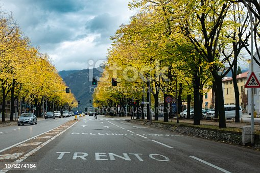 Bassano del Grappa, Italy - October 30, 2018:City center crossed by a long avenue surrounded by lime trees