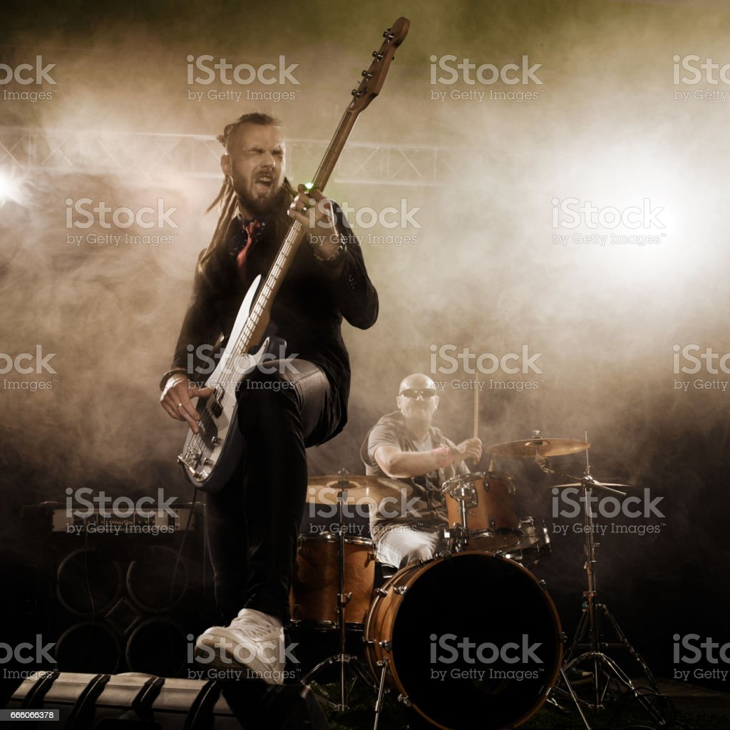 Bassist in the foreground. stock photo