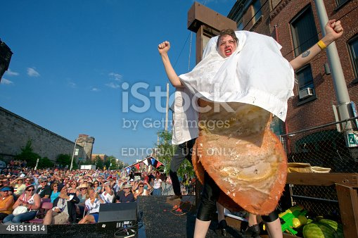 Philadelphia, PA, USA - July 11, 2015; An actress with the Bearded Ladies comedy troupe is seen preforming as 'the ghost of TastyKake', on stage, outside the historic Eastern State Penitentiary in Philadelphia during the annual Bastille Day celebrations. (photo by Bastiaan Slabbers)