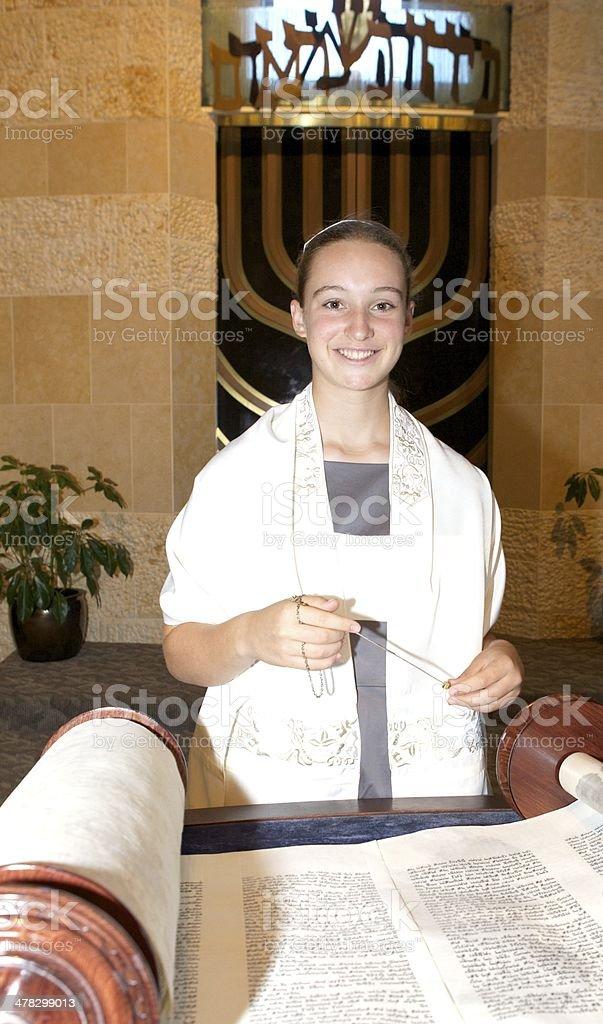 Bat Mitzvah Girl Smiling with Torah inside Temple stock photo