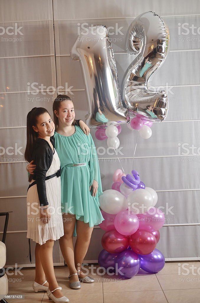 Bat Mitzvah girl with her older sister stock photo