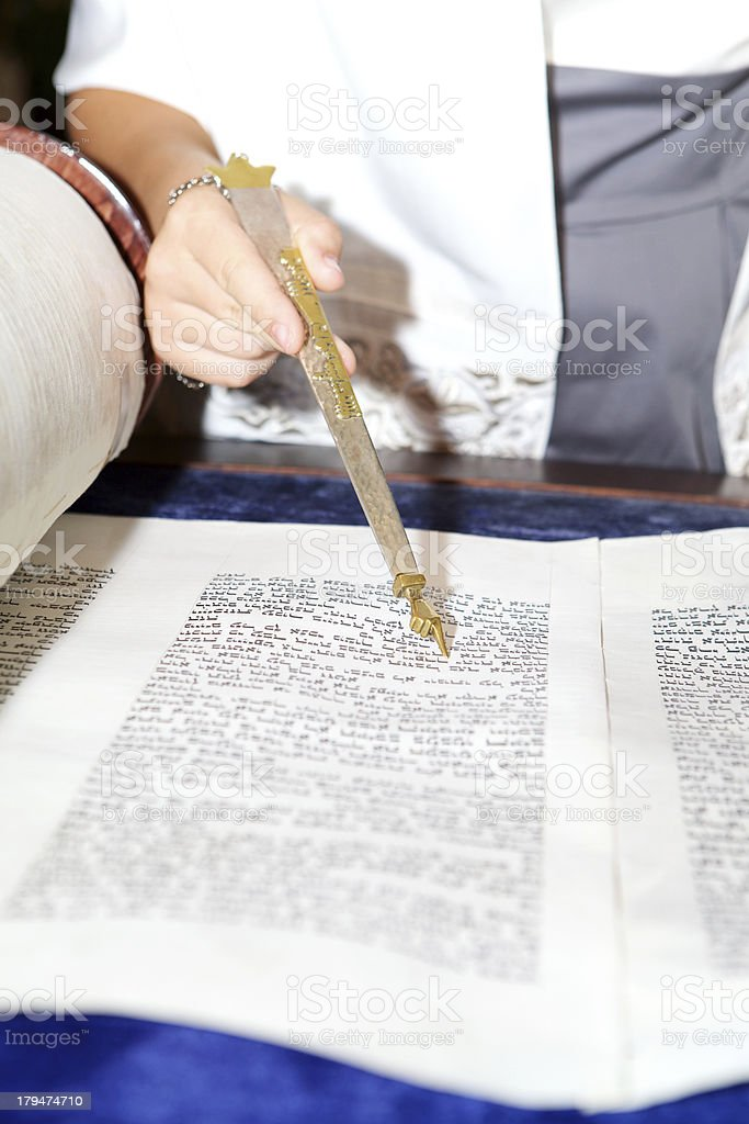 Bat Mitzvah Girl's Hand and Yad Reading Torah stock photo