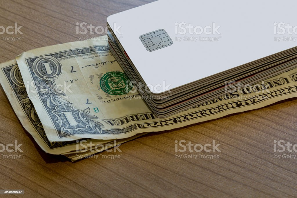 Batch of Credit or Debit Card on Dollar Notes stock photo