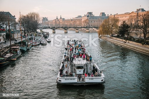 Paris, France. 22 January, 2017 - A Bateau Mouche tourboat, carrying a large amount of tourists over the Seine River in Paris, France.