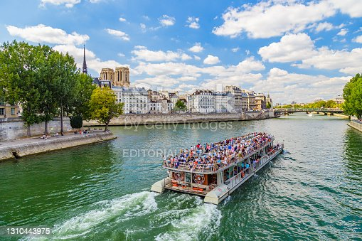 istock Bateau mouche on the River Seine on a sunny day 1310443975