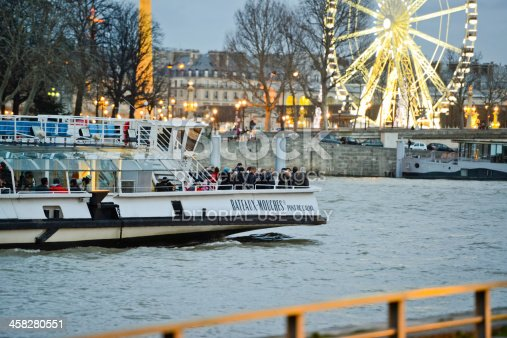 istock Bateaux-Mouche on Seine River, Christmas in Paris 458280551