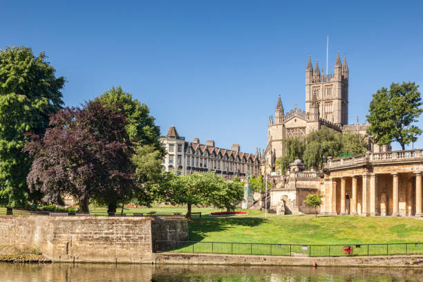 Bath Abbey and the Orangerie UK Bath Abbey and the Orangerie on the banks of the River Avon, on a beautiful summer morning with perfectly clear blue sky. Bath, Somerset, England, UK bath england stock pictures, royalty-free photos & images