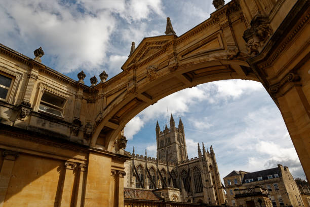 Bath Abbey Bath Exterior view of Abbey with the three tiers of  the facade and towers. bath abbey stock pictures, royalty-free photos & images