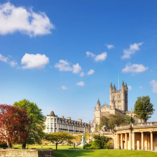 Bath Abbey Bath Abbey on a fine spring day. On the right is the Colonnade, and on the left is Orange Grove. somerset england stock pictures, royalty-free photos & images