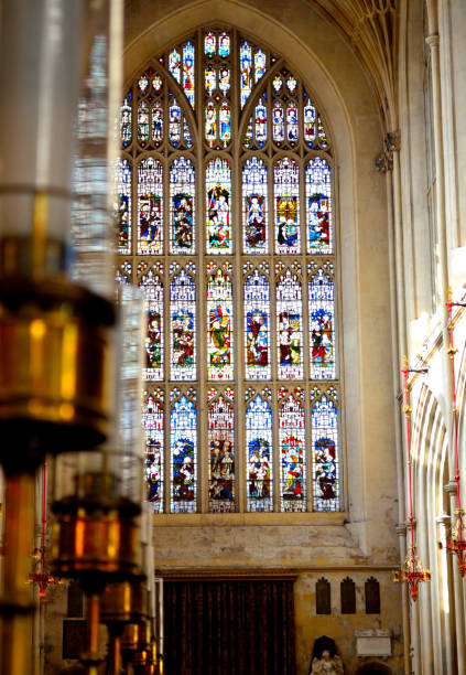 Bath Abbey Window Stained glass window inside Bath Abbey bath abbey stock pictures, royalty-free photos & images