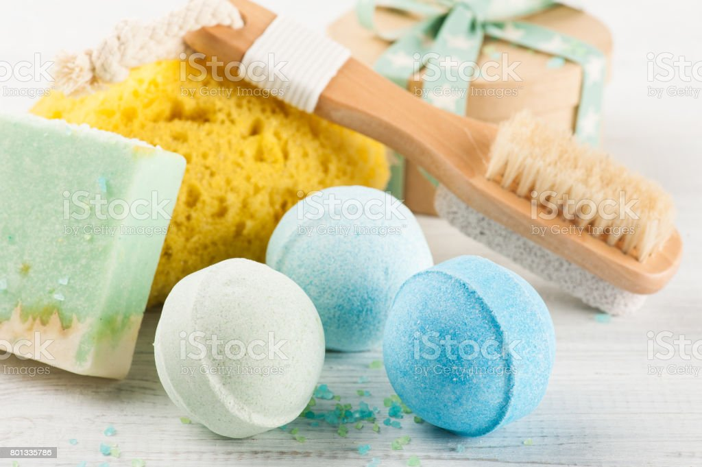 Bath accessories on white wooden table stock photo