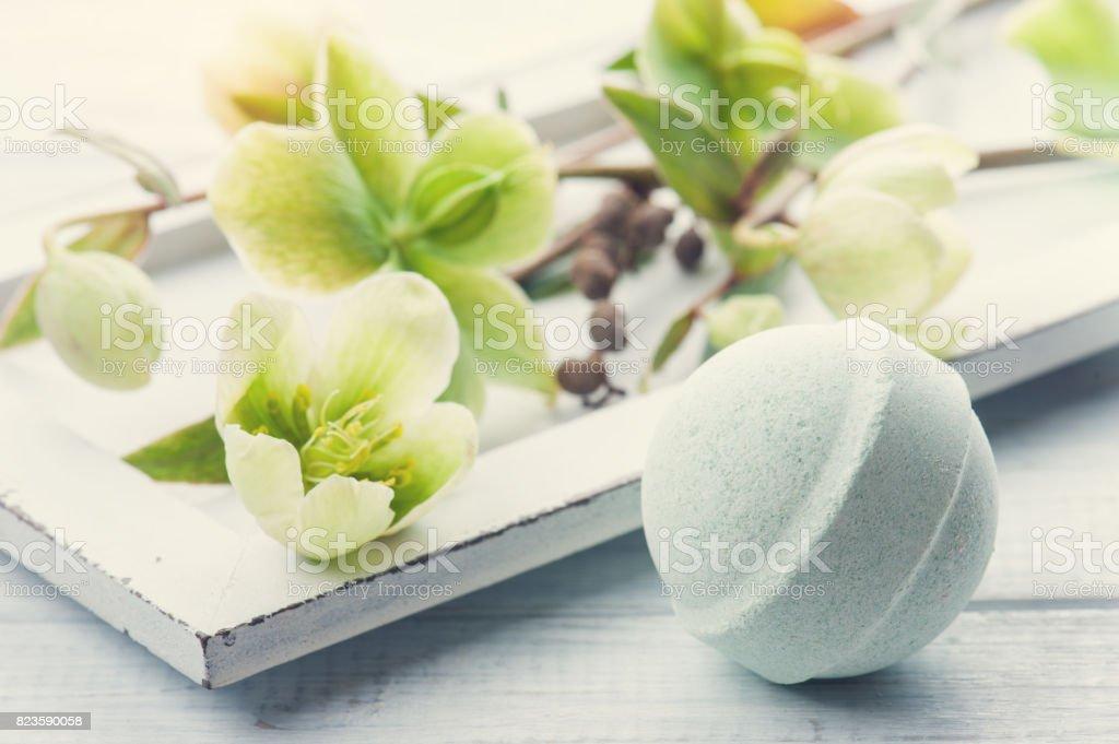 Bath bomb on white wooden background stock photo