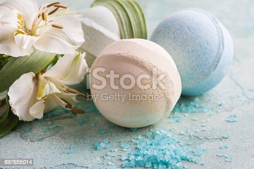 656780900istockphoto Bath bomb, soap and decorative flowers 697655014