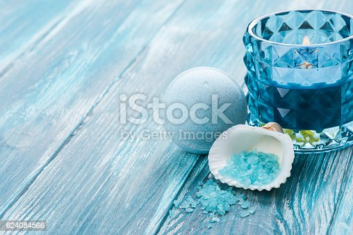 656780900istockphoto bath bombs closeup with blue lit candle 624084566