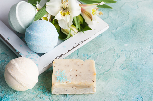 656780900 istock photo Bath bombs on blue concrete background 693803770