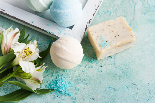 656780900 istock photo Bath bombs on blue concrete background 695234510