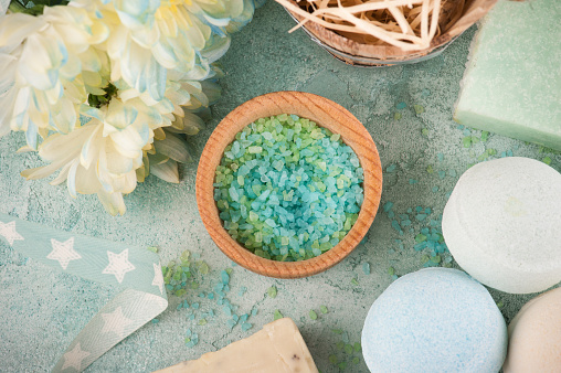 656780900 istock photo Bath bombs on blue concrete background 696015272