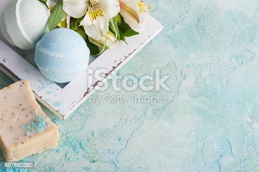 istock Bath bombs on blue concrete background 697692382