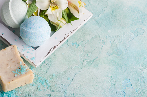 656780900 istock photo Bath bombs on blue concrete background 697692382