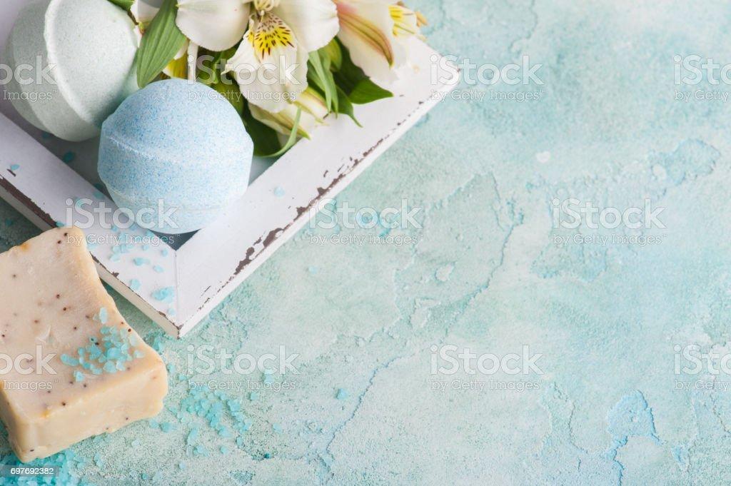 Bath bombs on blue concrete background stock photo