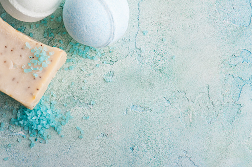 656780900 istock photo Bath bombs on blue concrete background 698107152