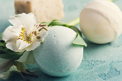 656780900 istock photo Bath bombs on blue concrete background 804037354