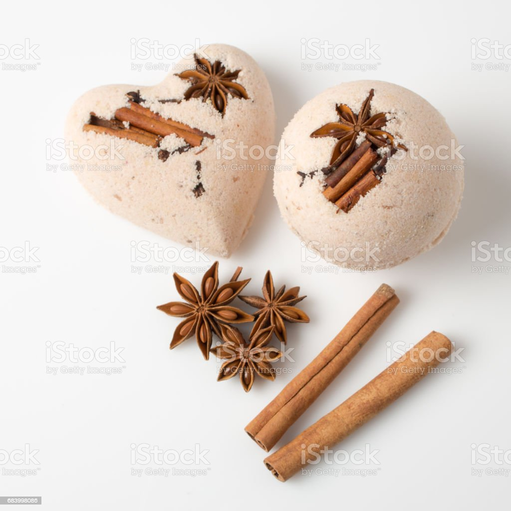 Bath bombs with cinnamon sticks and star anise stock photo