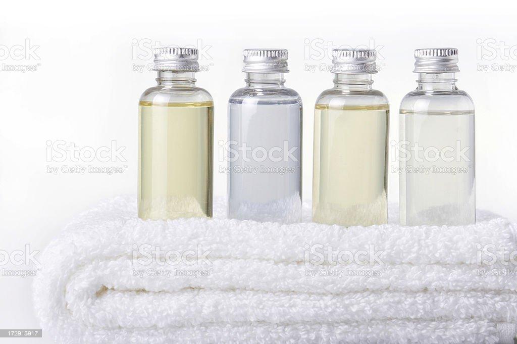 bath bottles on towel stock photo