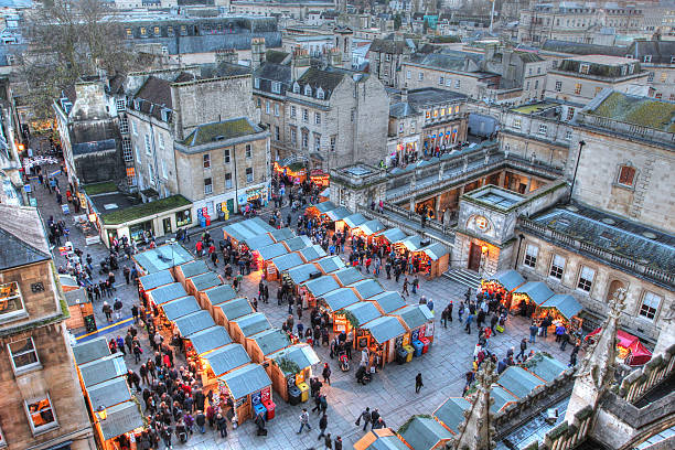 Bath Christmas Market and Roman Baths Taken from Bath Abbey, this image features the Bath Christmas Market and the Roman Baths late on a December afternoon. somerset england stock pictures, royalty-free photos & images