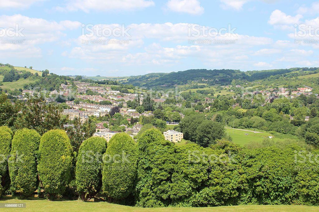 Bath city in summer, showing countryside views and conifer hedge stock photo