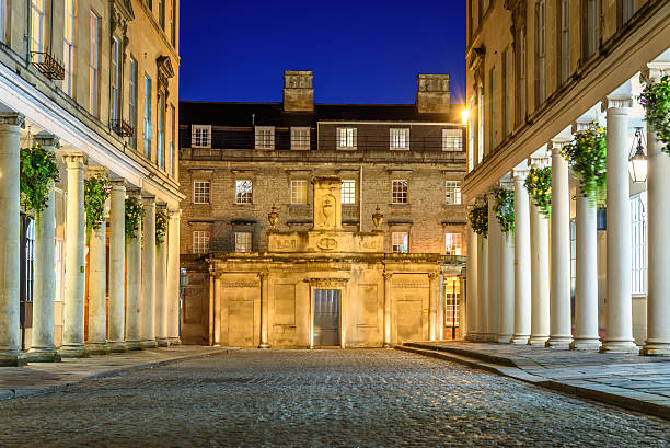 Bath city UK Cobbled streets of Bath city at night. bath england stock pictures, royalty-free photos & images