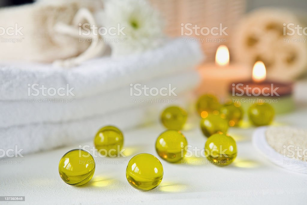Bath oil balls and candle royalty-free stock photo