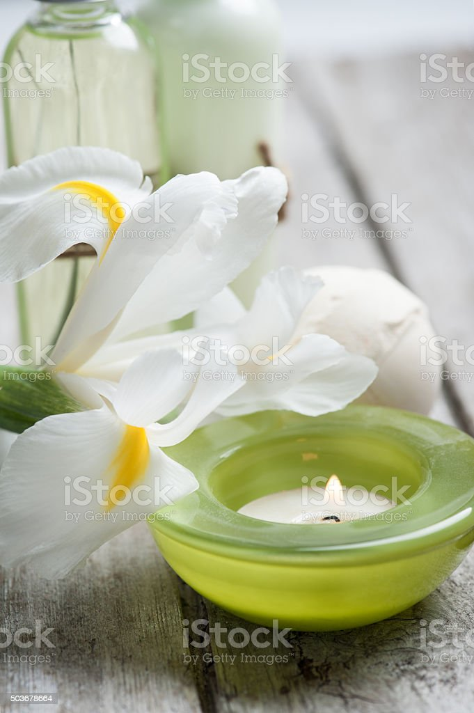 Bath products, candles, wooden background stock photo
