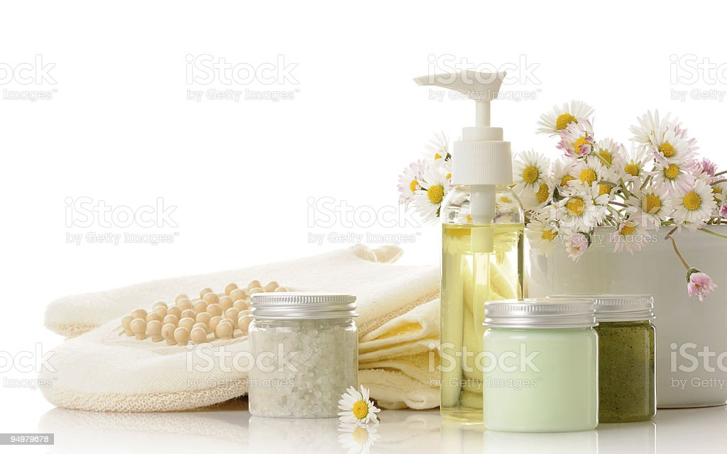 Bath products with a towel and flowers royalty-free stock photo