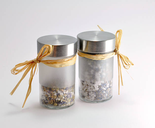 Bath salt in jars with herbs stock photo