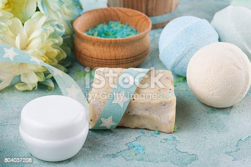 656780900istockphoto Bath salt, soap on blue concrete background 804037208