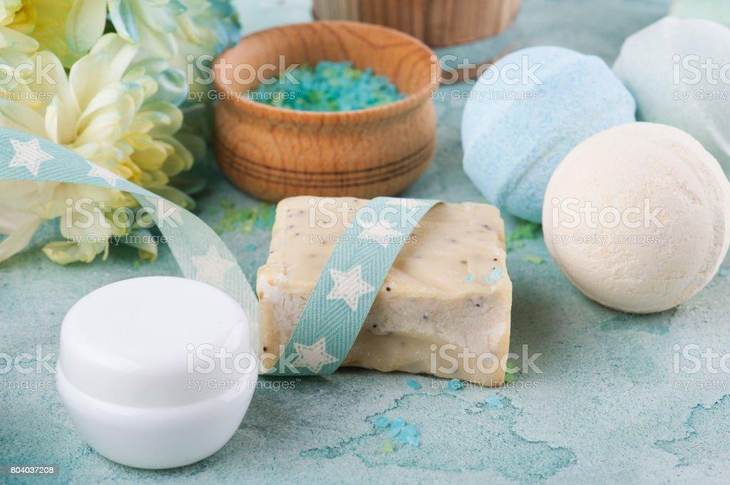 Bath salt, soap on blue concrete background stock photo
