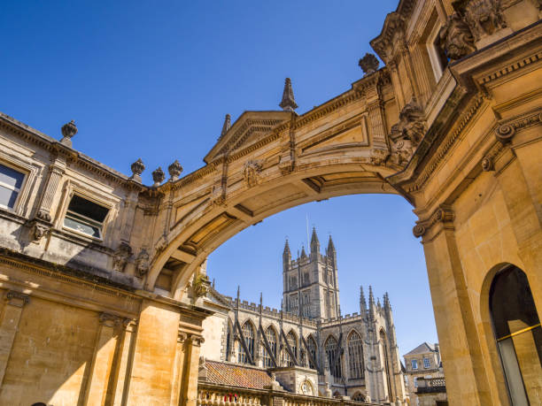 Bath Somerset England UK Bath, Somerset, England, UK - Bath Abbey seen through the York Street Arch. bath england stock pictures, royalty-free photos & images