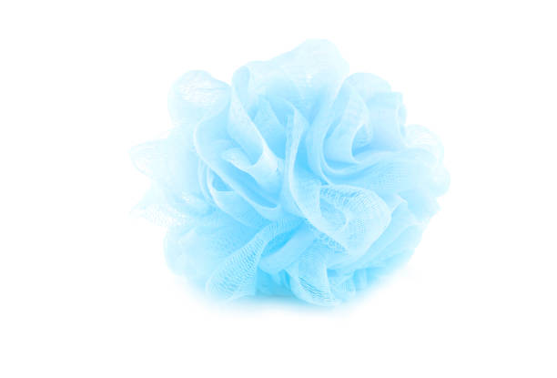 bad schwamm blau isoliert auf einem weißen hintergrund für peeling bad mit beschneidungspfad verwendet. - feminine badezimmer stock-fotos und bilder