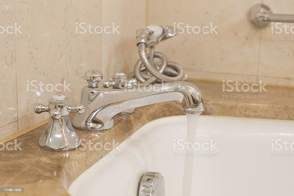Bath Taps Running royalty-free stock photo